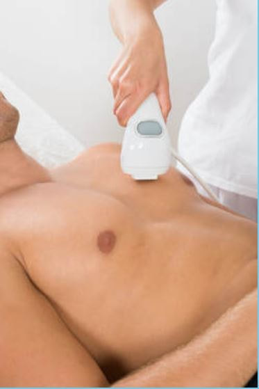 picture of a muscular man getting laser hair removal treatment on his chest.